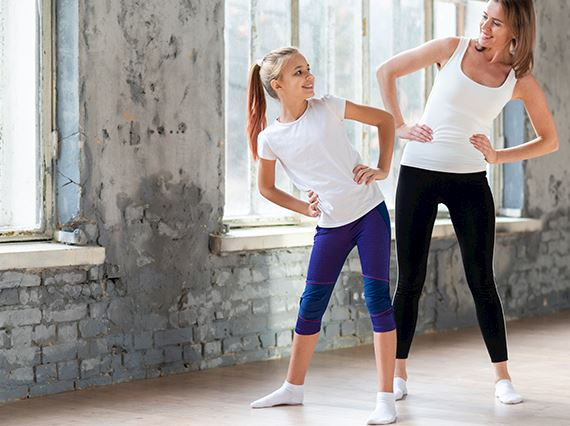mom & daughter are exercising together
